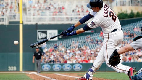 Minnesota Twins' Jason Castro hits an RBI single off Seattle Mariners starting pitcher Christian Bergman in the third inning of a baseball game Tuesday, June 13, 2017, in Minneapolis. (AP Photo/Jim Mone)