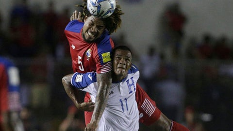 Panama's Roman Torres, top, heads the ball over Honduras' Rony Martinez during a 2018 Russia World Cup qualifying soccer match at Rommel Fernandez Stadium in Panama City, Tuesday, June 13, 2017. (AP Photo/Arnulfo Franco)