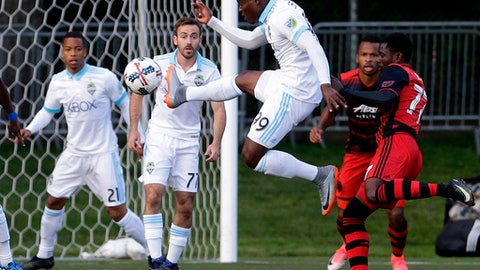 Seattle Sounders forward Felix Chenkam (99) leaps to kick the ball near the goal during the first half of the team's U.S. Open Cup soccer match against the Portland Timbers, Tuesday, June 13, 2017, in Tukwila, Wash. (AP Photo/Ted S. Warren)