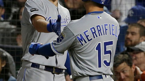 Kansas City Royals' Whit Merrifield (15) is congratulated by Eric Hosmer after scoring against the San Francisco Giants during the sixth inning of a baseball game in San Francisco, Tuesday, June 13, 2017. (AP Photo/Jeff Chiu)
