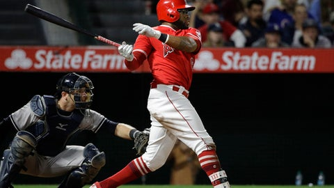 Los Angeles Angels' Eric Young Jr. hits a game-winning RBI single during the 11th inning of a baseball game against the New York Yankees, Tuesday, June 13, 2017, in Anaheim, Calif. The Angels won 3-2 in the 11th inning. (AP Photo/Jae C. Hong)