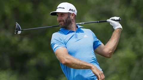 Dustin Johnson hits a drive on the 12th hole during a practice round for the U.S. Open golf tournament Wednesday, June 14, 2017, at Erin Hills in Erin, Wis. (AP Photo/David J. Phillip)