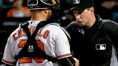 Baltimore Orioles catcher Welington Castillo checks on home plate umpire Quinn Wolcott after Wolcott was hit with a foul tipped ball from Chicago White Sox's Omar Narvaez during the first inning of a baseball game Wednesday, June 14, 2017, in Chicago. (AP Photo/Charles Rex Arbogast)