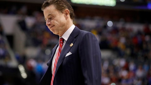 FILE - In this March 19, 2017, file photo, Louisville head coach Rick Pitino walks off the court after a 73-69 loss to Michigan in a second-round game in the men's NCAA college basketball tournament in Indianapolis. Louisville and coach Pitino are awaiting discipline from the NCAA on Thursday, June 15, 2017, regarding a sex scandal that engulfed the men's basketball program. A former men's basketball staffer is alleged to have hired strippers to entertain players and recruits.  (AP Photo/Jeff Roberson, File)