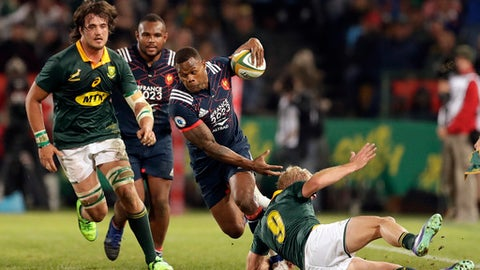 FILE- In this Saturday, June 10, 2017 file photo, France's Virimi Vakatawa, second from right, avoids a tackle from South Africa's Ross Cronje' bottom, during the international rugby union test match between South Africa and France at Loftus Versfeld stadium in Pretoria, South Africa. With captain Guilhem Guirado restored to the starting lineup as one of eight changes, France is close to full strength and expected to present a sterner challenge to South Africa's fledgling revival in the second test on Saturday. (AP Photo/Themba Hadebe, File)