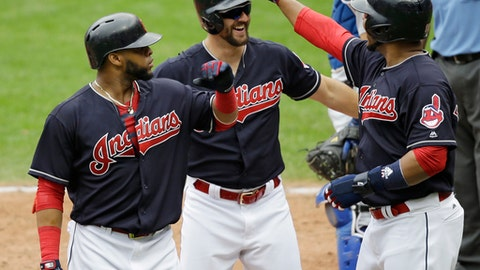 Cleveland Indians' Lonnie Chisenhall, center, is congratulated by Edwin Encarnacion, right, and Carlos Santana after Chisenhall hit a three-run home run in the fifth inning of a baseball game, Thursday, June 15, 2017, in Cleveland. Encarnacion and Santana scored on the play. (AP Photo/Tony Dejak)