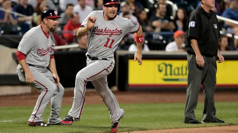 Washington Nationals' Ryan Zimmerman (11) rounds third base on his way home to score on a triple by Daniel Murphy against the New York Mets during the fifth inning of a baseball game, Thursday, June 15, 2017, in New York. (AP Photo/Julie Jacobson)