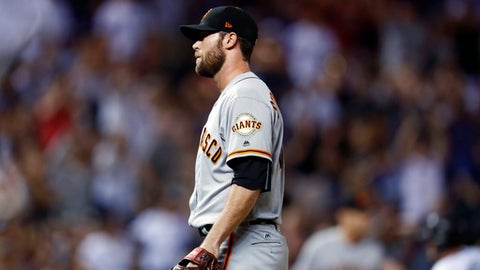 San Francisco Giants relief pitcher Hunter Strickland reacts after giving up a walk-off single to Colorado Rockies' Raimel Tapia during a baseball game Thursday, June 15, 2017, in Denver. The Rockies won 10-9. (AP Photo/David Zalubowski)