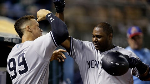 New York Yankees' Chris Carter, right, is congratulated by Aaron Judge (99) after hitting a home run against the Oakland Athletics during the eighth inning of a baseball game Thursday, June 15, 2017, in Oakland, Calif. (AP Photo/Ben Margot)