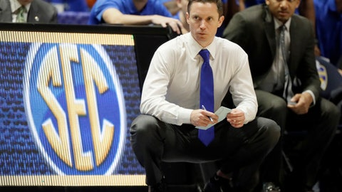 FILE- In this March 10, 2017, file photo, Florida head coach Mike White watches during the second half of an NCAA college basketball game against Vanderbilt at the Southeastern Conference tournament in Nashville, Tenn. Florida has given raises and extensions to football coach Jim McElwain and White, keeping both under contract into 2023. (AP Photo/Wade Payne, File)