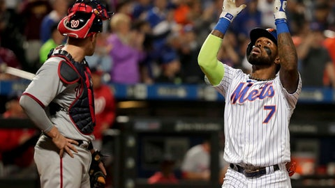 New York Mets' Jose Reyes (7) reacts as he crosses home plate after hitting a solo home run against the Washington Nationals during the eighth inning of a baseball game, Friday, June 16, 2017, in New York. (AP Photo/Julie Jacobson)
