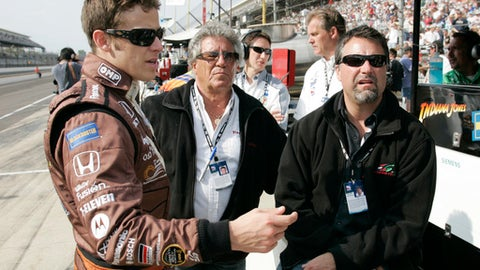 FILE - In this May 10, 2008, file photo, Marco Andretti, left, his father and car owner, Michael Andretti, right, and his grandfather Mario Andretti talk in the pit area on the first day of qualifications for the Indianapolis 500 auto race at Indianapolis Motor Speedway in Indianapolis. The Andretti's are one of many father-son duos in sports around the world spending time together on a daily basis.  (AP Photo/Tom Strattman, File)