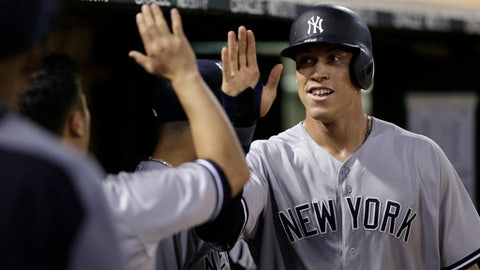 New York Yankees' Aaron Judge, right, is congratulated after scoring against the Oakland Athletics during the seventh inning of a baseball game Friday, June 16, 2017, in Oakland, Calif. (AP Photo/Ben Margot)
