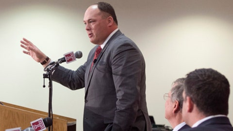 FILE - In this Dec. 14, 2016, file photo, Geoff Collins speaks during an NCAA college football news conference in Philadelphia, where he was introduced as Temple's new head football coach. Collins, former Florida defensive coordinator, has brought swag and Nick Saban structure to Temple. (Ed Hille/The Philadelphia Inquirer via AP)