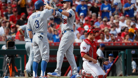 Los Angeles Dodgers' Cody Bellinger (35) celebrates his two-run home run alongside Chris Taylor (3) as Cincinnati Reds catcher Devin Mesoraco mans home plate in the third inning of a baseball game, Saturday, June 17, 2017, in Cincinnati. (AP Photo/John Minchillo)