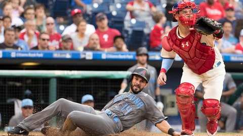 Arizona Diamondbacks' Reymond Fuentes, left, slides in to score on the single by Daniel Descalso as Philadelphia Phillies catcher Andrew Knapp, right, looks for the ball during the seventh inning of a baseball game, Saturday, June 17, 2017, in Philadelphia. (AP Photo/Chris Szagola)