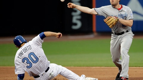 Washington Nationals second baseman Daniel Murphy (20) throws out New York Mets' Yoenis Cespedes at first base after forcing out Michael Conforto (30) to end the baseball game, Saturday, June 17, 2017, in New York. The Nationals won 7-4. (AP Photo/Frank Franklin II)