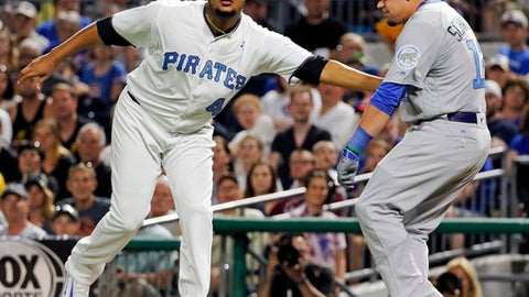 Pittsburgh Pirates starting pitcher Ivan Nova, left, tags out Chicago Cubs' Kyle Schwarber along the first base line after fielding  Schwarber's grounder during the seventh inning of a baseball game in Pittsburgh, Saturday, June 17, 2017. The Pirates won 4-3. (AP Photo/Gene J. Puskar)