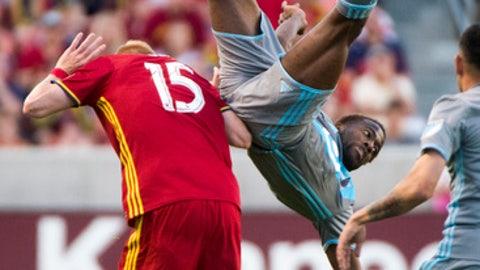 Minnesota United midfielder Kevin Molino tumbles over Real Salt Lake defender Justen Glad (15) during an MLS soccer match in Sandy, Utah, Saturday, June 17, 2017. (Rick Egan/The Salt Lake Tribune via AP)