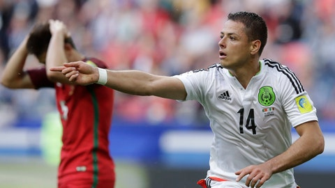 Mexico's Javier Hernandez celebrates after scoring his side's first goal during the Confederations Cup, Group A soccer match between Portugal and Mexico, at the Kazan Arena, Russia, Sunday, June 18, 2017. (AP Photo/Thanassis Stavrakis)