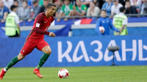 Portugal's Cristiano Ronaldo runs with the ball during the Confederations Cup, Group A soccer match between Portugal and Mexico, at the Kazan Arena, Russia, Sunday, June 18, 2017. (AP Photo/Thanassis Stavrakis)