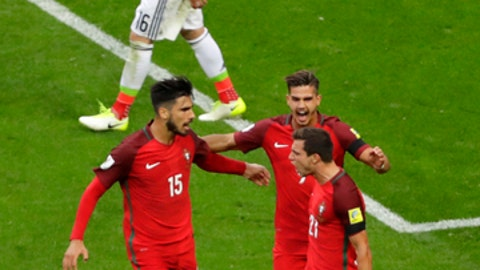 Portugal's Cedric Soares, right, celebrates scoring his side's second goal during the Confederations Cup, Group A soccer match between Portugal and Mexico, at the Kazan Arena, Russia, Sunday, June 18, 2017. (AP Photo/Sergei Grits)