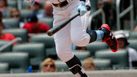 Atlanta Braves' Nick Markakis reacts after being hit by a pitch from Miami Marlins' Jose Urena in the third inning of a baseball game Sunday, June 18, 2017, in Atlanta. (AP Photo/John Bazemore)