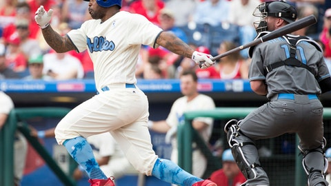 Philadelphia Phillies' Howie Kendrick hits a single to record his 1500 career hit during the third inning of a baseball game against the Arizona Diamondbacks, Sunday, June 18, 2017, in Philadelphia. (AP Photo/Chris Szagola)