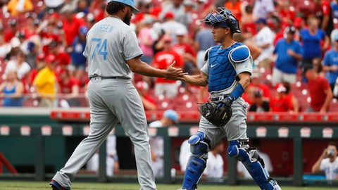 Los Angeles Dodgers relief pitcher Kenley Jansen (74) and third baseman Logan Forsythe, right, celebrate after closing the ninth inning of a baseball game against the Cincinnati Reds, Sunday, June 18, 2017, in Cincinnati. (AP Photo/John Minchillo)