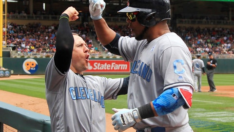 CORRECTS TO ENCARNACION NOT INCARNACION - Cleveland Indians' Edwin Encarnacion, right, is congratulated by teammate Daniel Robertson after hitting a home run in the third inning of a baseball game against the Minnesota Twins, Sunday, June 18, 2017, in Minneapolis. (AP Photo/Andy Clayton-King)