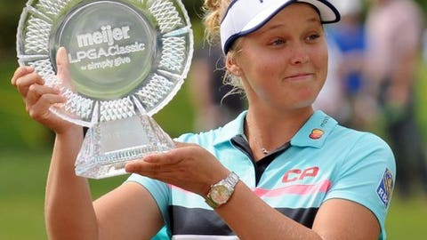 Brooke Henderson, of Canada, poses with the trophy after winning the Meijer LPGA Classic golf tournament at Blythefield Country Club. Sunday, June 18, 2017, in Grand Rapids, Mich.. (Cory Olsen/The Grand Rapids Press via AP)