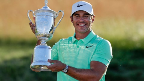 Brooks Koepka poses with the winning trophy after the U.S. Open golf tournament Sunday, June 18, 2017, at Erin Hills in Erin, Wis. (AP Photo/Chris Carlson)