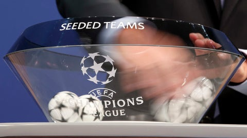 Balls containing the names of the soccer clubs are removed, during the drawing of the games for the Champions League 2017/18 Second qualifying round, at the UEFA headquarters in Nyon, Switzerland, Monday, June 19, 2017. (Salvatore Di Nolfi/Keystone via AP)