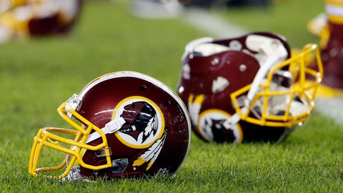 FILE - In this Dec. 26, 2015, file photo, a Washington Redskins helmet sits on the field as players warm-up before an NFL football game against the Philadelphia Eagles in Philadelphia. A recent national poll, conducted by the Washington Post, finds that nine of 10 Native Americans aren't offended by the Washington Redskins name.  A federal judge ordered the cancellation of the Redskins' trademark registration in July, ruling that their name may be disparaging to Native Americans. The club is appealing. (AP Photo/Matt Rourke, File)