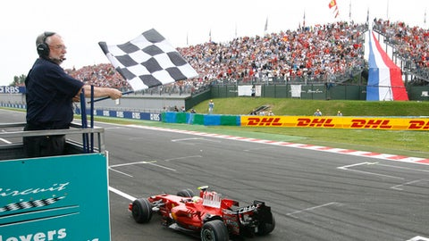 FILE - A Sunday June 22, 2008 file photo showing Ferrari driver Felipe Massa, of Brazil, getting the checkered flag to win the French Formula One Grand Prix, at the Magny Cours racetrack, central France. The French GP, returns after a 10-year absence and will be hosted at the iconic Paul Ricard circuit, also known as Le Castellet, in southern France. Paul Ricard last hosted the French GP in 1990. The race was then organized at Magny-Cours from 1991-2008 but was then dropped from the calendar in 2008 because of financial issues. (AP Photo/David Vincent, File)