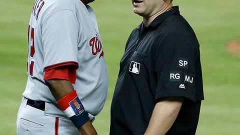 Washington Nationals manager Dusty Baker, left, argues a call with first base umpire Clint Fagan during the third inning of a baseball game against the Miami Marlins, Monday, June 19, 2017, in Miami. (AP Photo/Wilfredo Lee)
