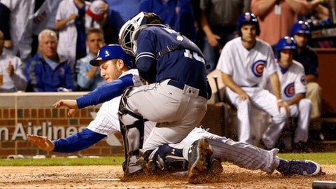 San Diego Padres catcher Austin Hedges tags out Chicago Cubs' Anthony Rizzo during a collision at home on a throw from Matt Szczur during the sixth inning of a baseball game Monday, June 19, 2017, in Chicago. (AP Photo/Charles Rex Arbogast)