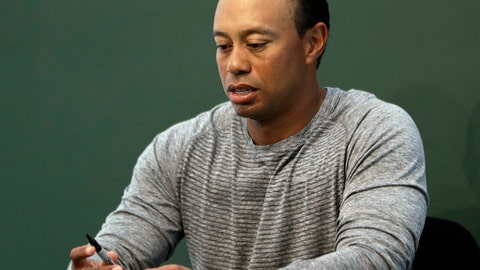 "FILE - In this March 20, 2017, file photo, golfer Tiger Woods prepares to sign copies of his new book at a book signing in New York. Woods is receiving help to manage his medications. ""I'm currently receiving professional help to manage my medications and the ways that I deal with back pain and a sleep disorder,"" Woods said in a statement provided to The Associated Press on Monday, June 19. (AP Photo/Seth Wenig, File)"