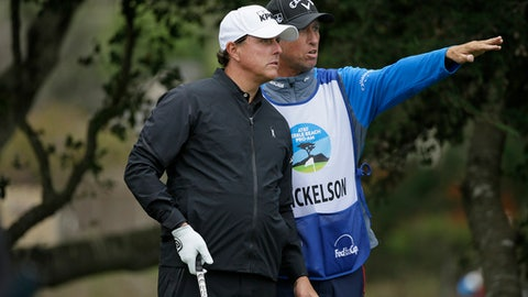 "Phil Mickelson listens to his caddie Jim ""Bones"" Mackay before hitting from the fifth tee of the Monterey Peninsula Country Club Shore Course during the first round of the AT&T Pebble Beach National Pro-Am golf tournament Thursday, Feb. 9, 2017, in Pebble Beach, Calif. (AP Photo/Eric Risberg)"
