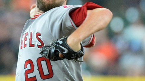 FILE - In this Thursday, April 20, 2017 file photo, Los Angeles Angels reliever Bud Norris pitches against the Houston Astros in a baseball game in Houston. Angels closer Bud Norris has been placed on the 10-day disabled list because of right knee inflammation, Tuesday, June 20, 2017. (AP Photo/George Bridges, File)