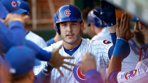 Chicago Cubs' Anthony Rizzo celebrates in the dugout after his lead off home run against San Diego Padres starting pitcher Jhoulys Chacin during the first inning of a baseball game Tuesday, June 20, 2017, in Chicago. (AP Photo/Charles Rex Arbogast)