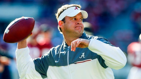 FILE - In this Saturday, Nov. 26, 2016 file photo, Alabama offensive coordinator Lane Kiffin throws a pass during warmups before the Iron Bowl NCAA football game against Auburn in Tuscaloosa, Ala. There is little incentive for teams outside the Power Five conferences _ the so-called Group of Five conferences to load up on games against each other. Quite literally, it does not pay enough for these schools to play. New Florida Atlantic coach Lane Kiffin begins at Annapolis, Maryland, against a Navy team that has gone 20-7 in its first two seasons as a member of the American .(AP Photo/Butch Dill, File)
