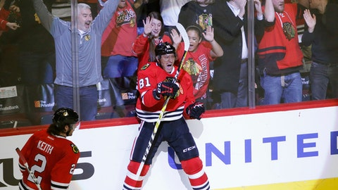 FILE - In this Thursday, Dec. 1, 2016, file photo, Chicago Blackhawks' Marian Hossa (81) celebrate his game winning goal as Duncan Keith (2) watches during the overtime period of an NHL hockey game against the New Jersey Devils, in Chicago. Hossa will miss the entire 2017-18 NHL season because of a progressive skin disorder, the team announced the news early Wednesday, June 21, 2017 (AP Photo/Charles Rex Arbogast, File)