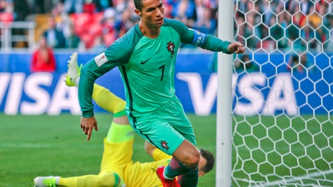 Portugal's Cristiano Ronaldo celebrates after scoring his side's first goal during the Confederations Cup, Group A soccer match between Russia and Portugal, at the Spartak Stadium in Moscow, Wednesday, June 21, 2017. (AP Photo/Ivan Sekretarev)