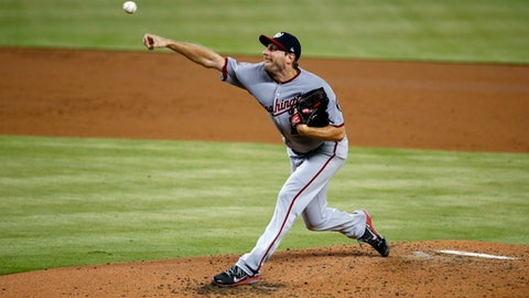 Washington Nationals' Max Scherzer delivers a pitch during the third inning of a baseball game against the Miami Marlins, Wednesday, June 21, 2017, in Miami. (AP Photo/Wilfredo Lee)
