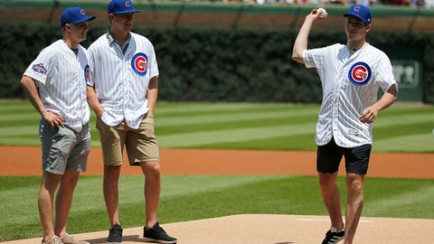 Top NHL draft prospects Casey Mittlestadt, Gabriel Vilardi watch as Nolan Patrick throws out a ceremonial first pitch before a baseball game between the Chicago Cubs and the San Diego Padres Wednesday, June 21, 2017, in Chicago. (AP Photo/Charles Rex Arbogast)