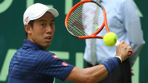 Japan's  Kei Nishikori returns a shot to Russia's Karen Khachanov during their match at the Gerry Weber Open tennis tournament, in Halle, Germany, Thursday, June 22, 2017.  (Friso Gentsch/dpa via AP)