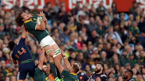 FILE - In this Saturday, June 10, 2017 file photo, South Africa's Franco Mostert' top, right, wins the ball against France's Yoann Huget, top left, during the international rugby union test match between South Africa and France at Loftus Versfeld stadium in Pretoria, South Africa. If Springboks coach Allister Coetzee is as relieved as South African rugby fans are, he's hidden it well. Having won successive tests for the first time in nearly a year, and put an end for now to a drastic slump, Coetzee's assessment of South Africa's series win over France has been clearly cautious. (AP Photo/Themba Hadebe, file)