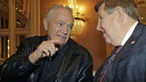 """Hall of Fame football coach Frank Kush, left,  speaks to former Marshall University coach Jack Lengyel at the 2010 Eddie Robinson Coach of the Year press conference and announcment in New York, Monday, Dec. 6, 2010.  Lengyel was the inspiration for the film, """"We Are Marshall,"""" in which he is portrayed by actor Matthew McConaughy. (AP Photo/Kathy Willens)"""