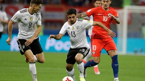Germany's Leon Goretzka, left, looks on as Germany's Lars Stindl, center, and Chile's Pablo Hernandez challenge for the ball during the Confederations Cup, Group B soccer match between Germany and Chile, at the Kazan Arena, Russia, Thursday, June 22, 2017. (AP Photo/Thanassis Stavrakis)
